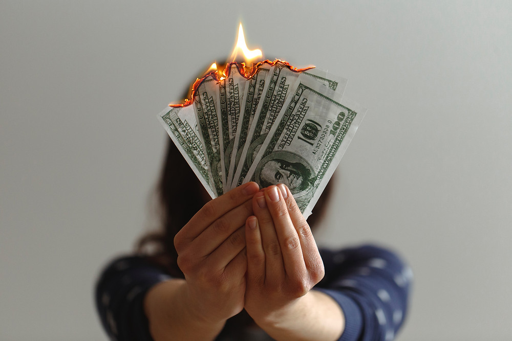 someone burning money