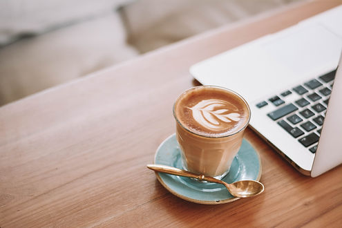 Laptop and Coffee Website Design Background