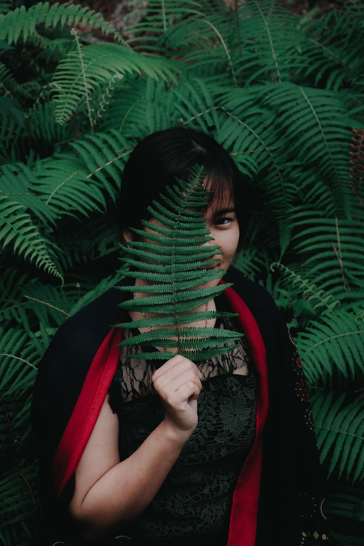 Girl hiding behind plant