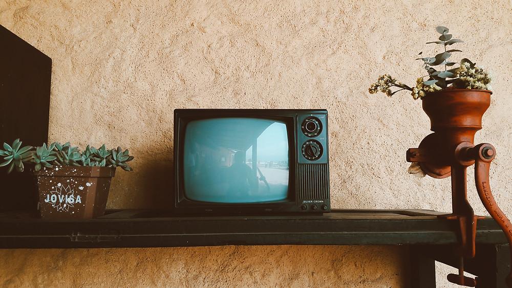 Retro television or TV set.