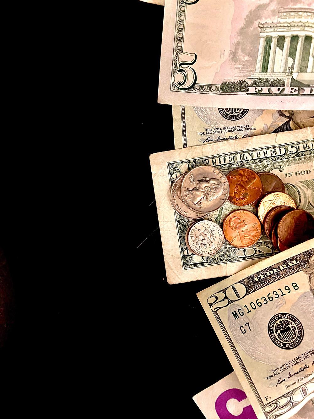 sort of money cash and coin, 20 dollar bill 5 dollars