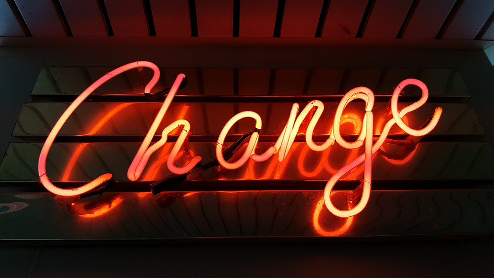 "A neon sign that reads, ""Change."""