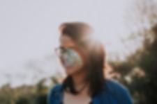 Autistalline Autism Glasses on Happy Smiling Lady