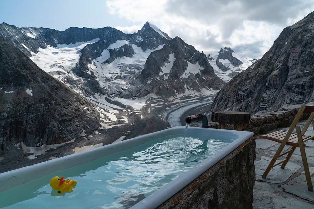 Ice bath with snowy mountains in the background