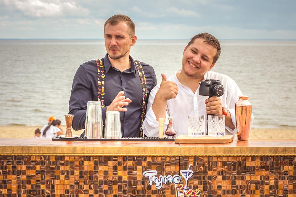 Bartender influencers on of social media making cocktails.