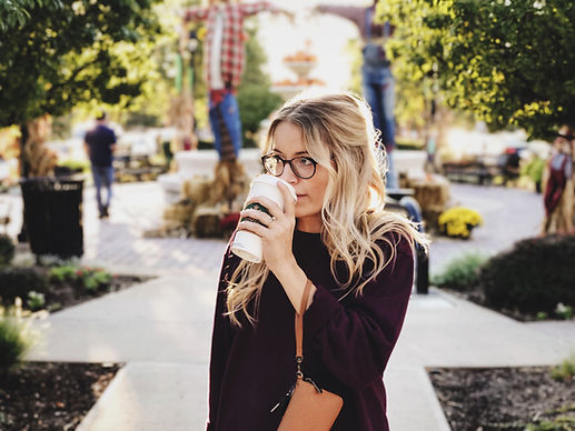 Woman Drinking Coffee with Blonde Balayaged Hair