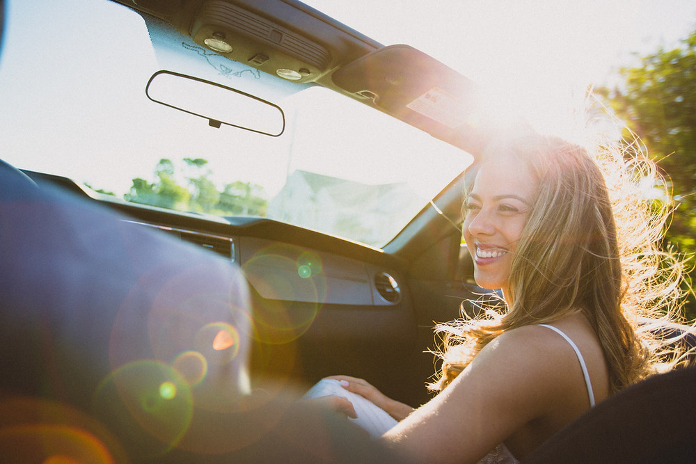 Smiling Girl in convertible