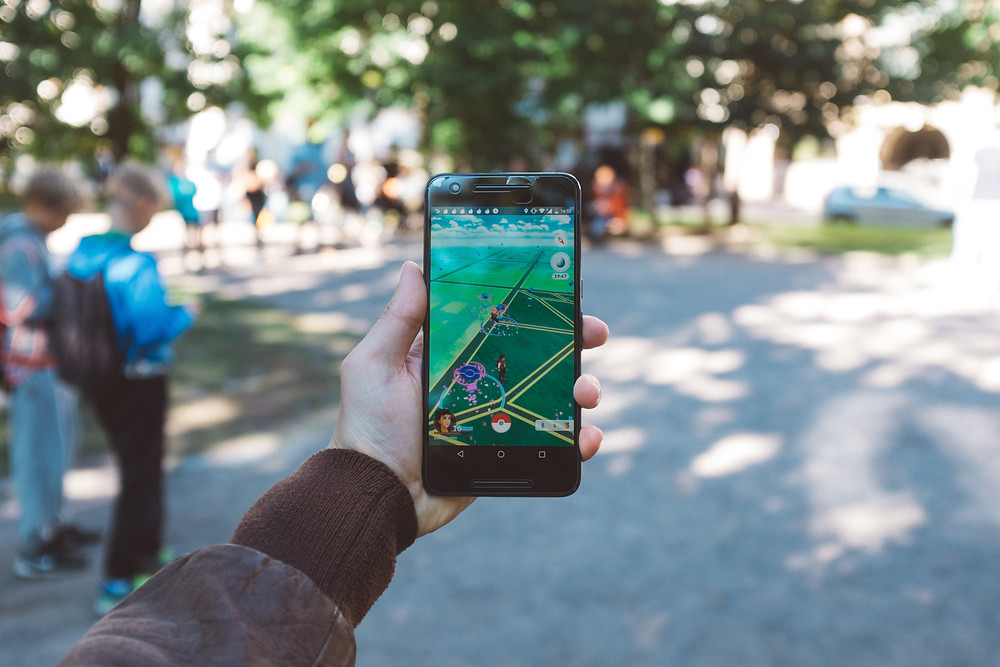 A person playing pokemon Go.
