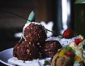 Falafel and other Kosher foods. Image by Louis Hansel @shotsoflouis