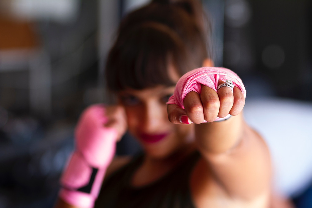 girl with martial arts gear punching
