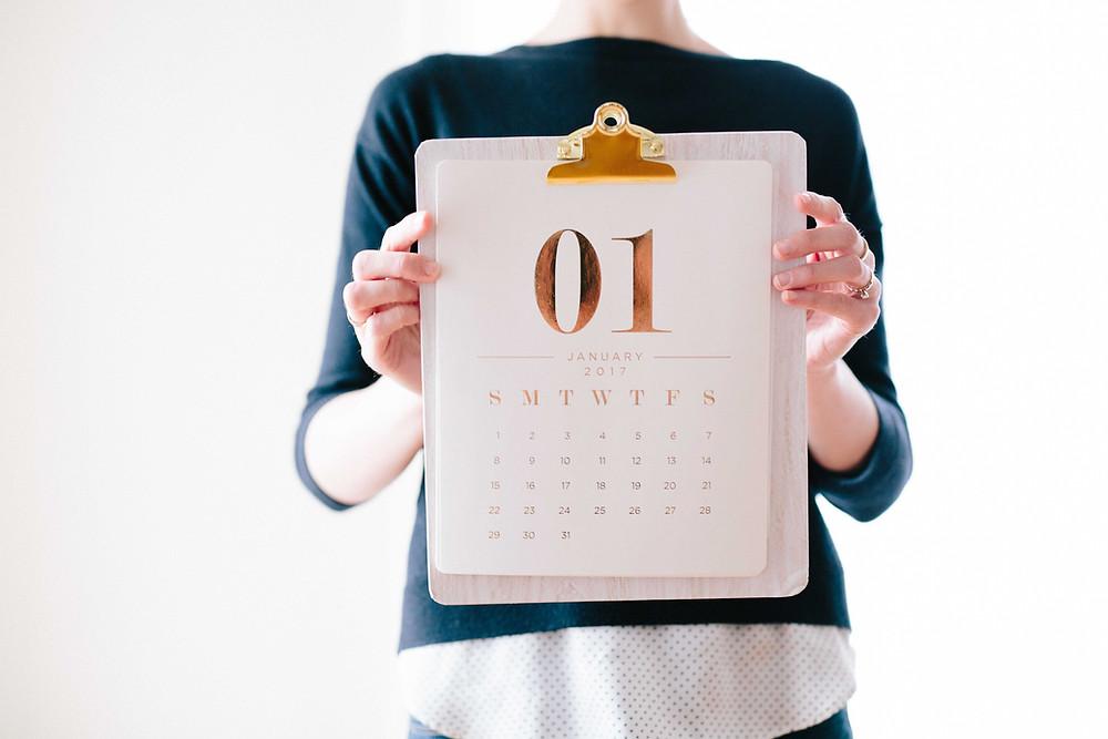 holding up calendar