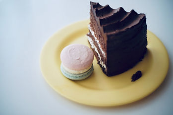 Slice of chocolate cake with macaronImage by insung yoon