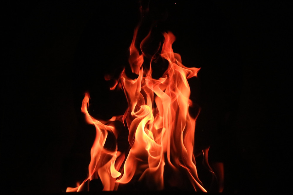 Fire against a black background Hannah Duncan Investment Content Ltd
