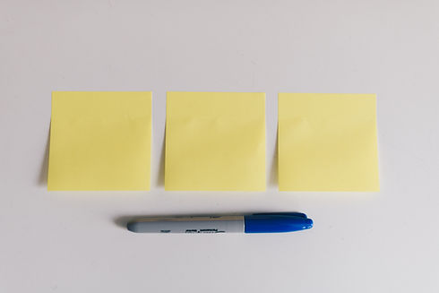 Post-It notes and a blue marker