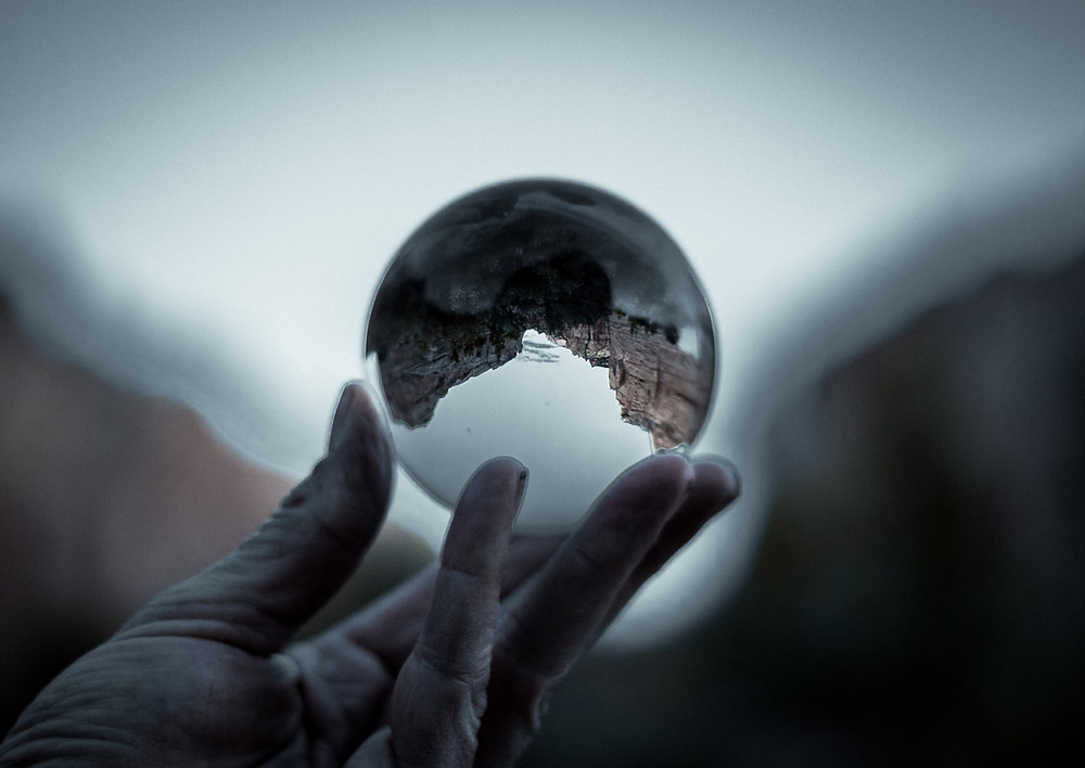 world viewed upside down, holding the world in palm of hand