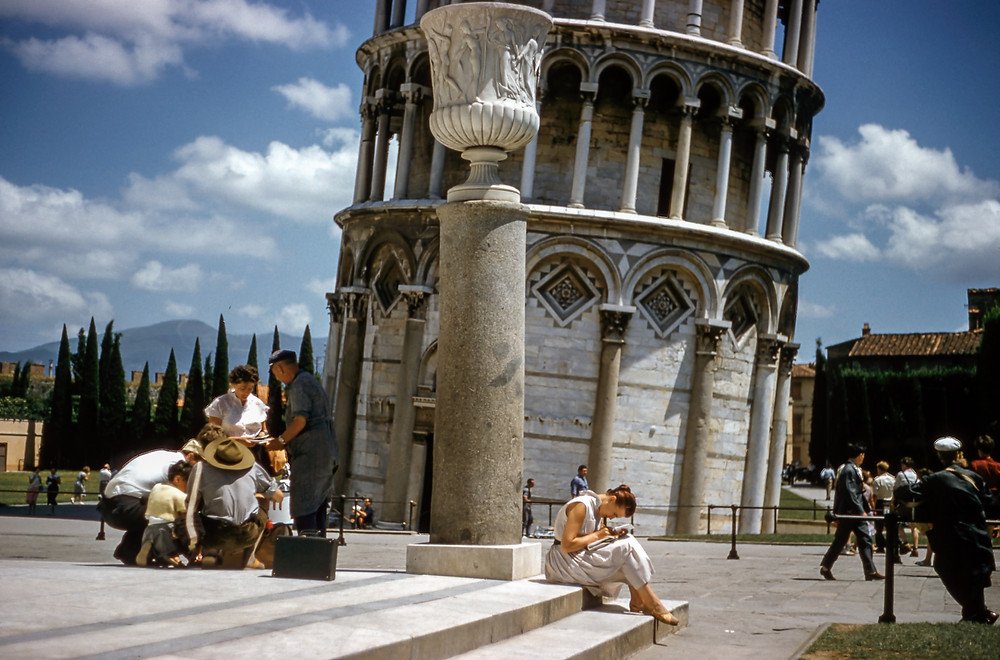 tourists at the base of the Leaning Tower of Pisa