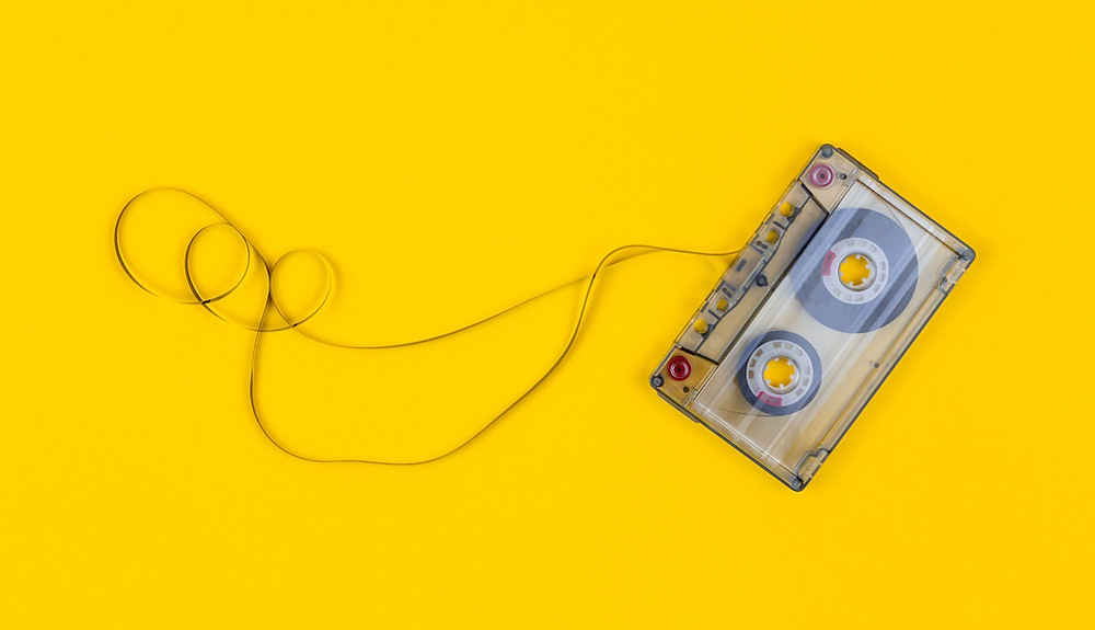 An old cassette tape with the magnetic tape strung out.