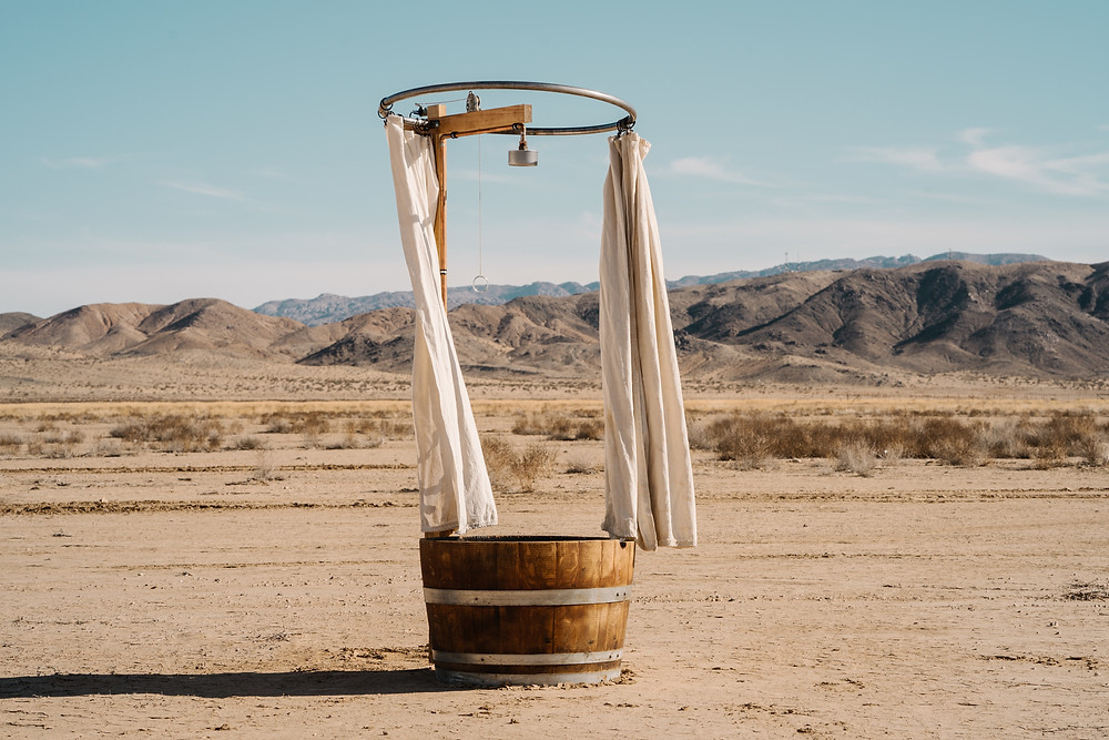 A quaint bucket shower in the middle of the desert