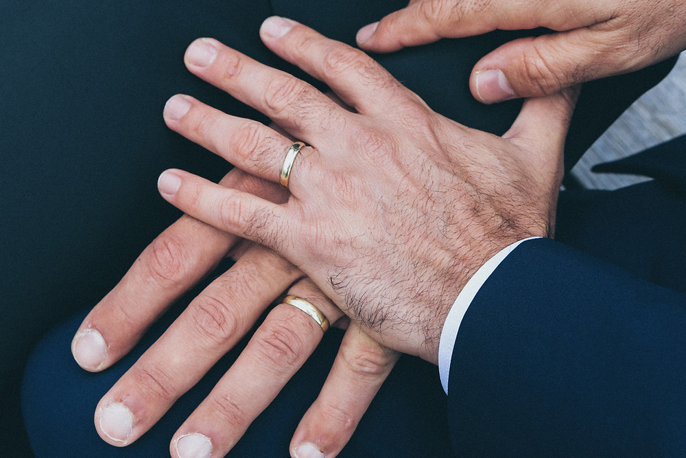 two-male-hands-showing-engagement-rings