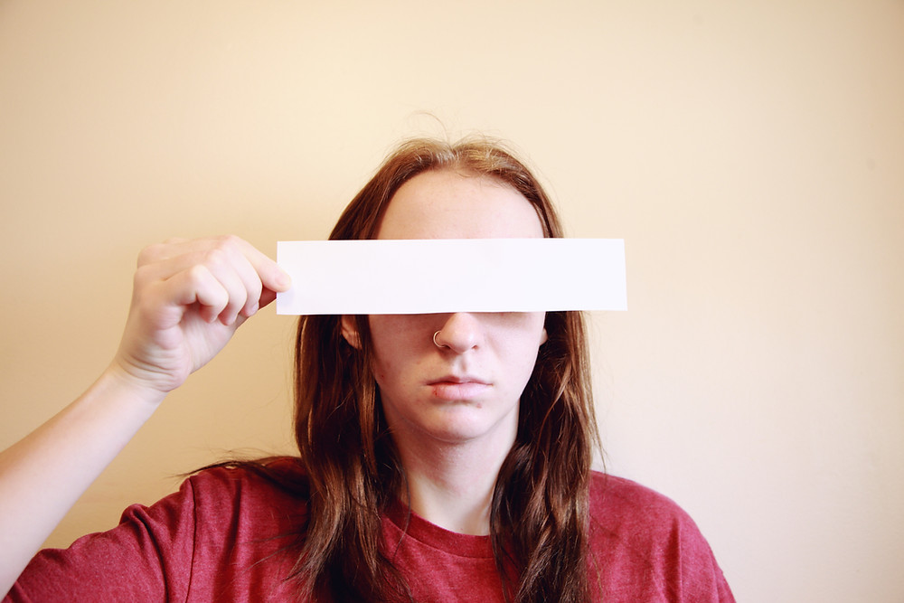 Man with censorship strip over his eyes.