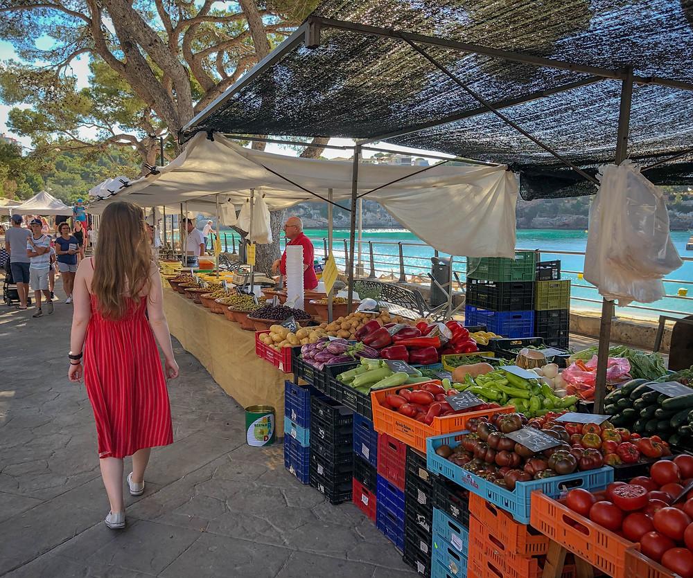 Woman walking at a farmers market.
