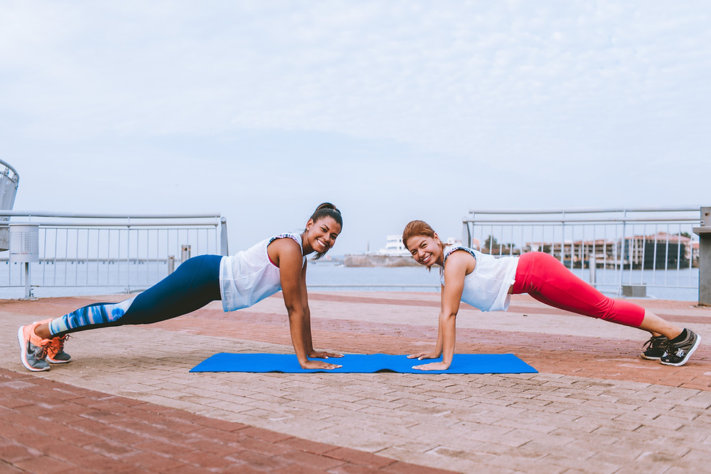 2 women doing high plank