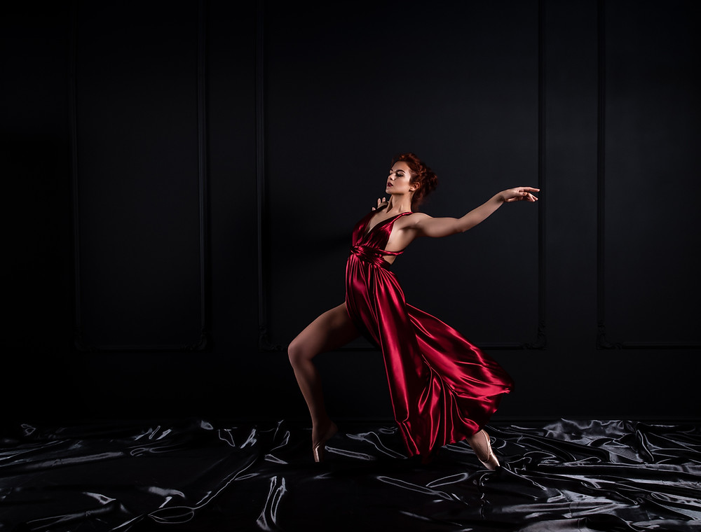 woman dancing gracefully in a red dress