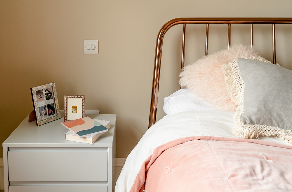 pink bed journal side table sleep