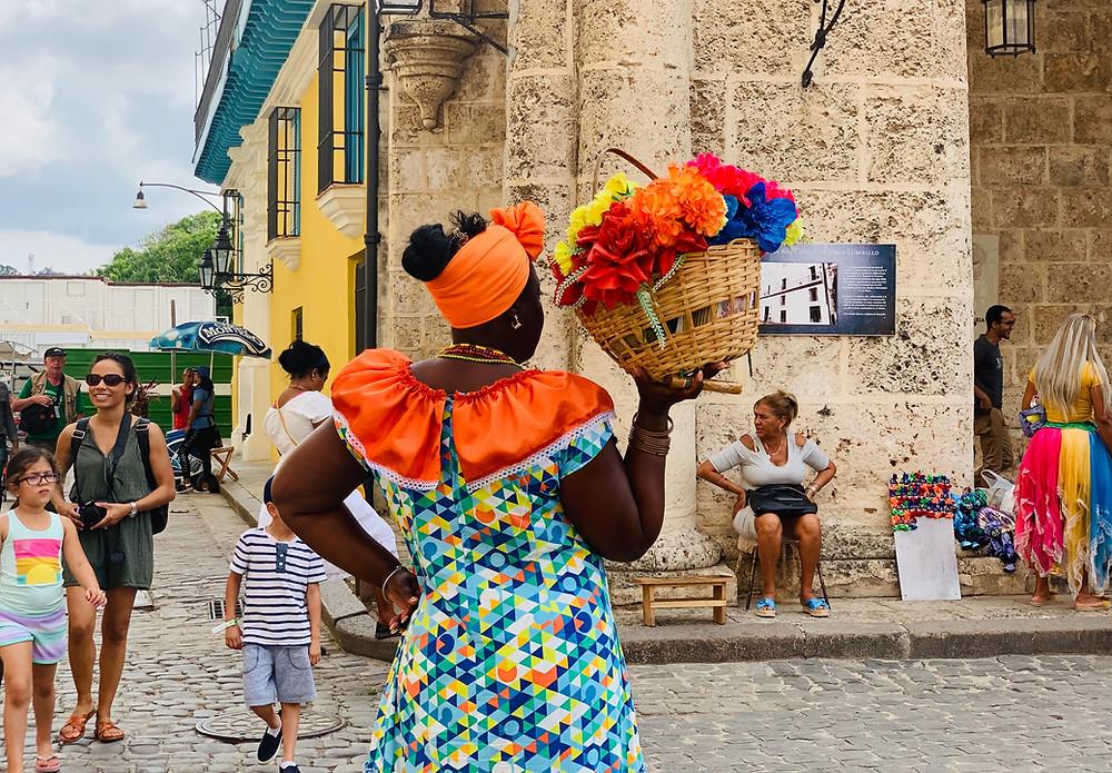 A women on a plaza in Havana
