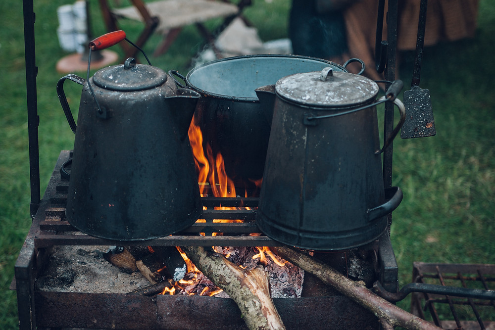 Coffee pots cooking over a fire