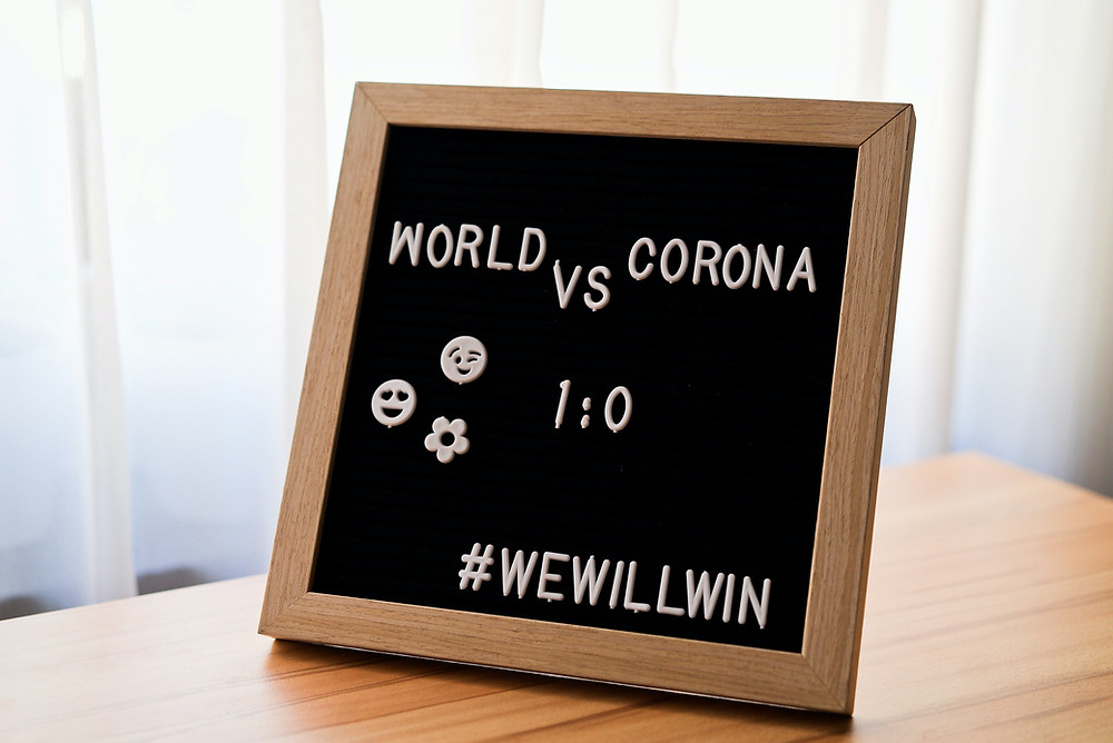 A Sign In Therapist Anabelle Bugatti's Counseling Office About Overcoming Corona Virus As A World