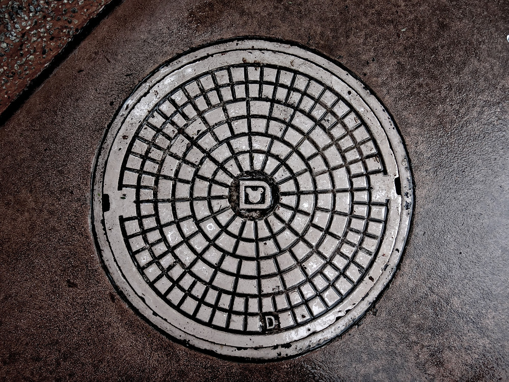 Image shows a typical manhole on the floor. Book a 3-Manhole CCTV Drain Survey in London with Drainsmart.