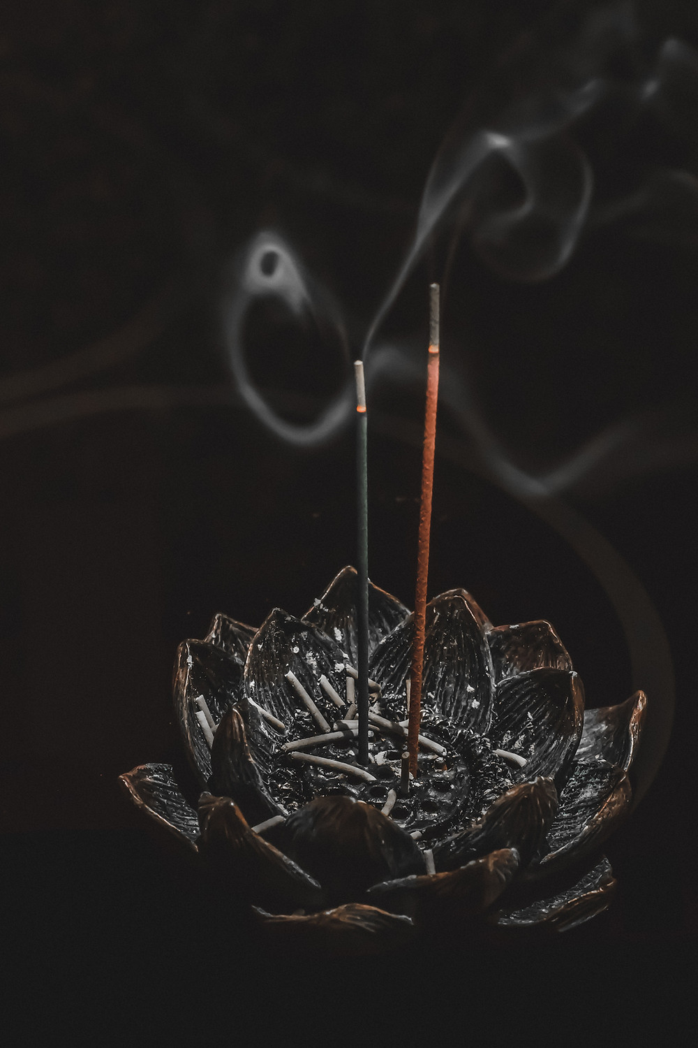 picture of incense sticks in a lotus flower holder energy cleansing