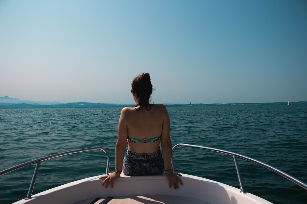 Woman on front of boat