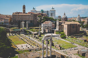 The Roman Forum as seen from the top of the Colisseum. Victor Emmanuel II monument sits in the background. Plan my trip to Rome