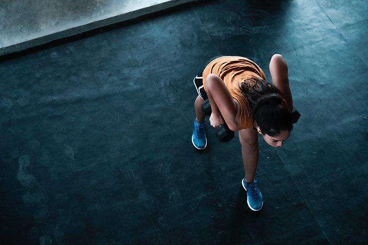 Female exercising at gym melbourne