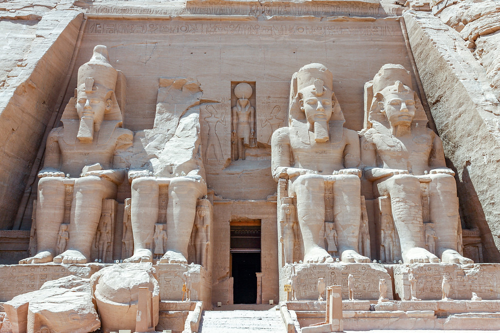 large sandstone figures in front of the Abu Simple temple
