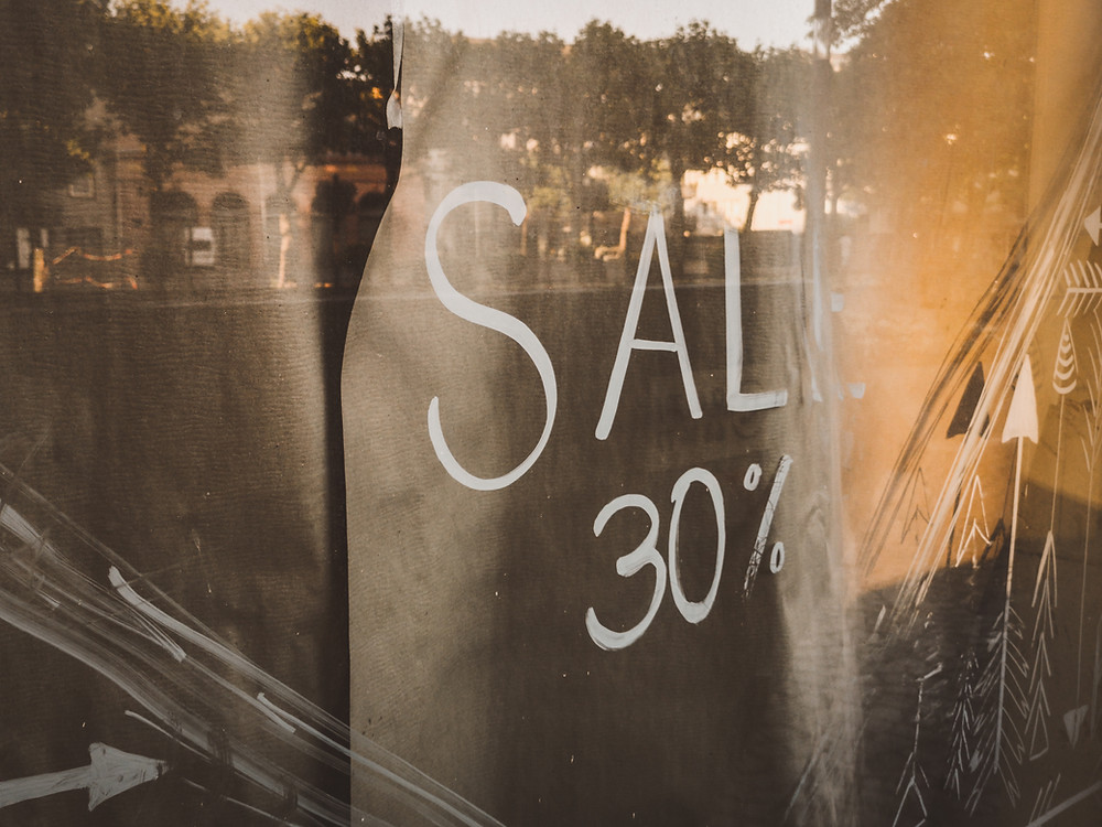 30% sale sign in a window