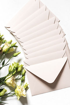 Mailing Envelopes on a table with flowers - Image by Diana Akhmetianova