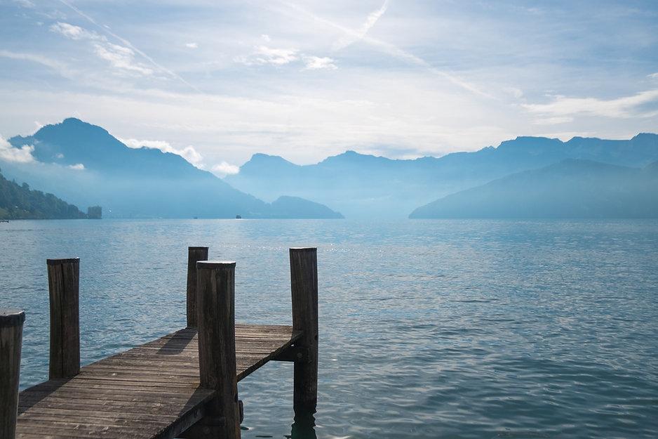 dock peaceful lake mountains