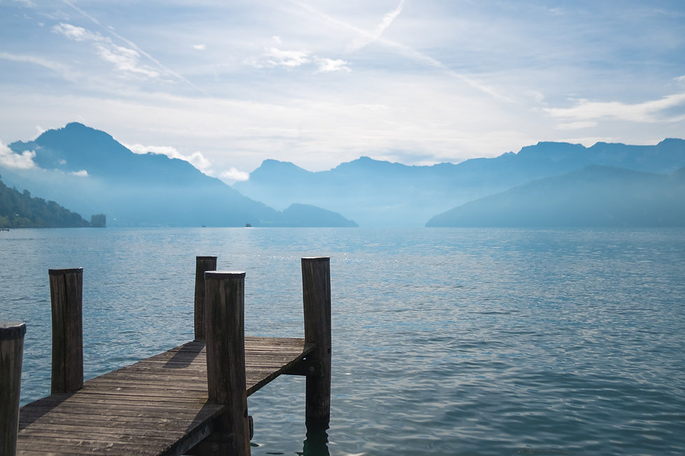 Pier in water with mountains ahead