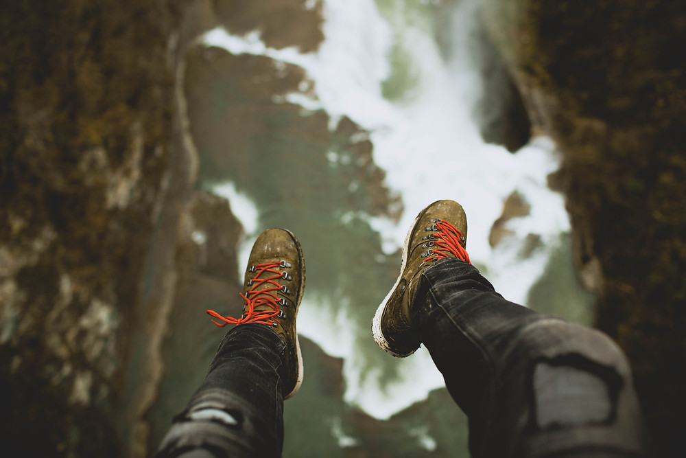 Looking down at your feet while falling into the river.