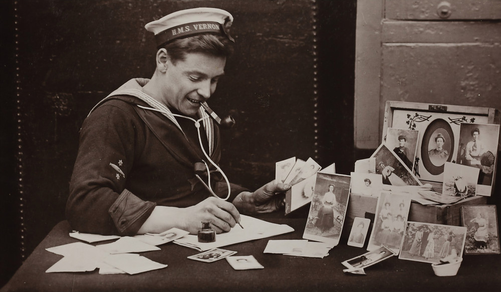 world war 2 sailor writing a letter