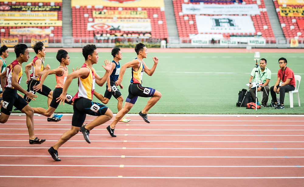 athletes in a race at the finish line
