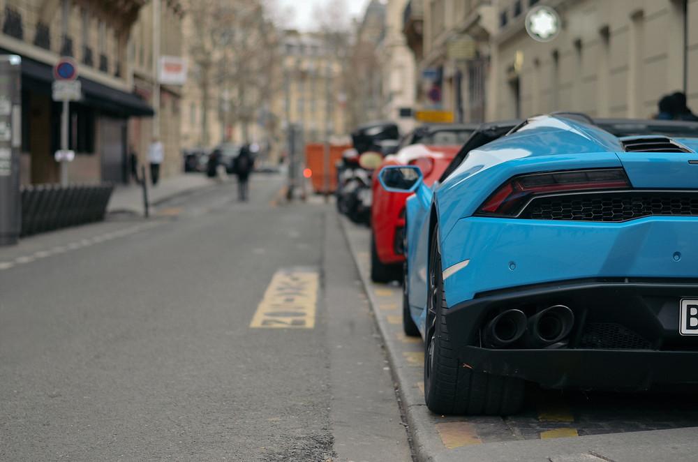 lamborghini and ferrari parked on the street