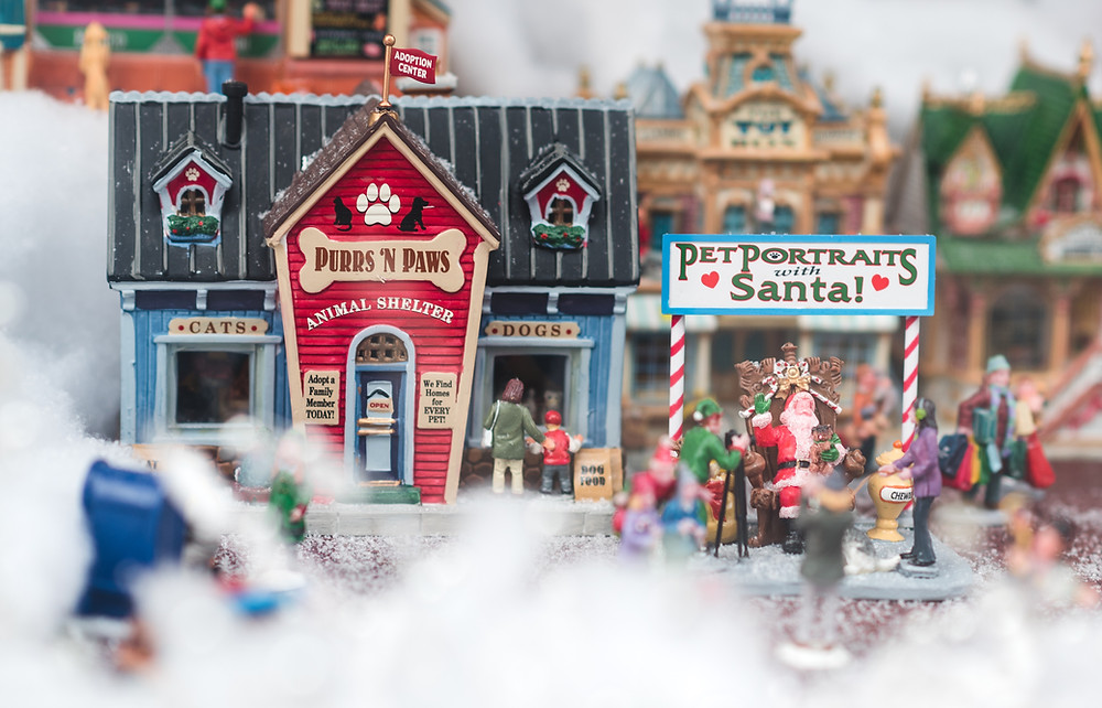 a miniature Christmas village with figurines