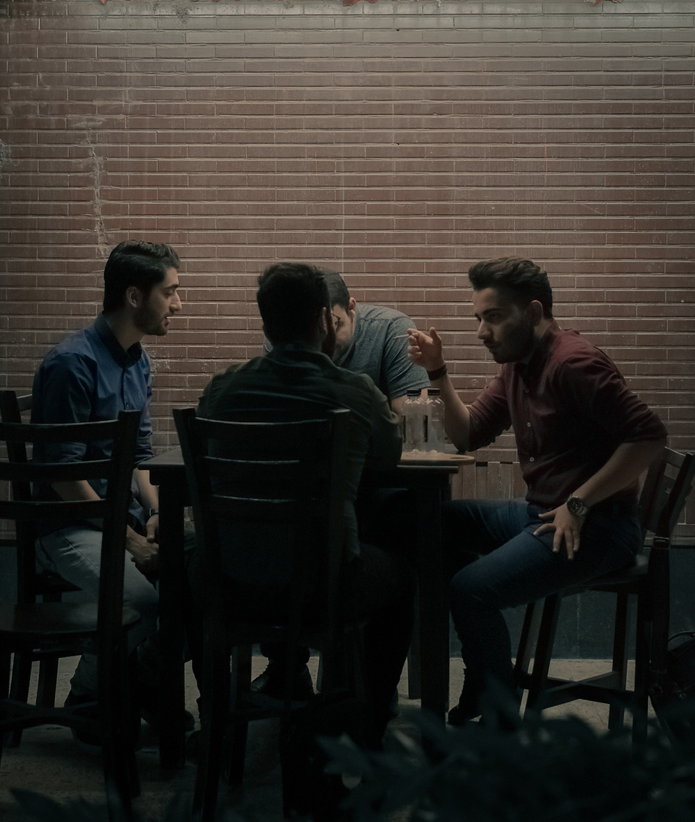 Men participate in group therapy in Denver Colorado. Catalyss Counseling provides treatment for depression and anxiety in Colorado through online therapy and in person counseling in the Denver area 80209 and 80210