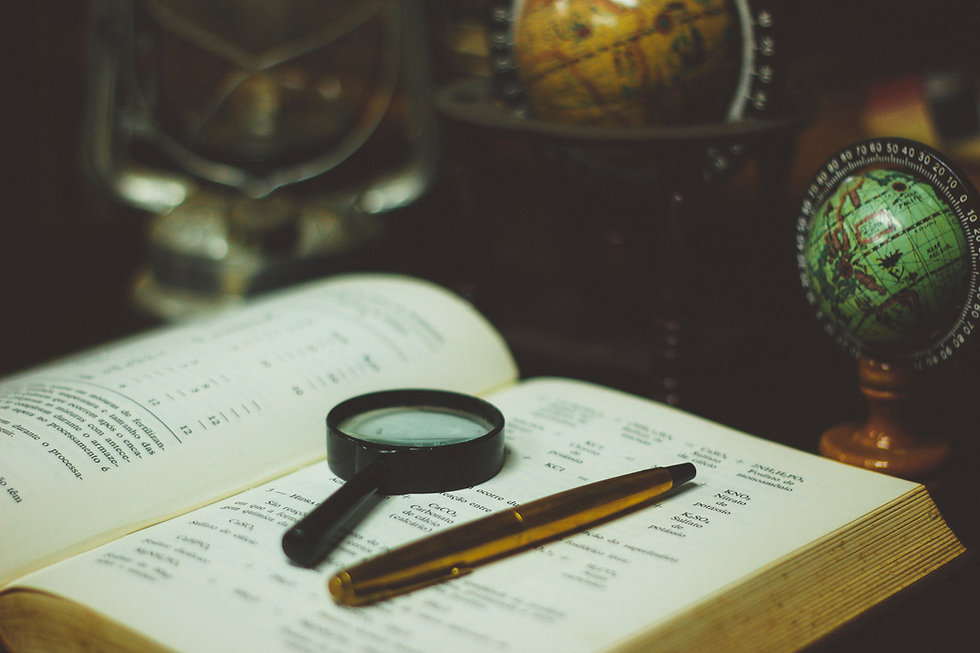 Book, magnifying glass, and pen