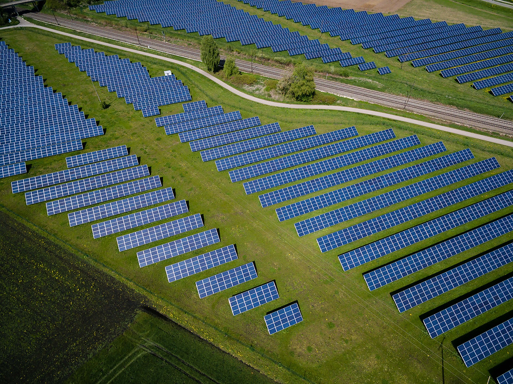 an arial view of a large solar farm in a field
