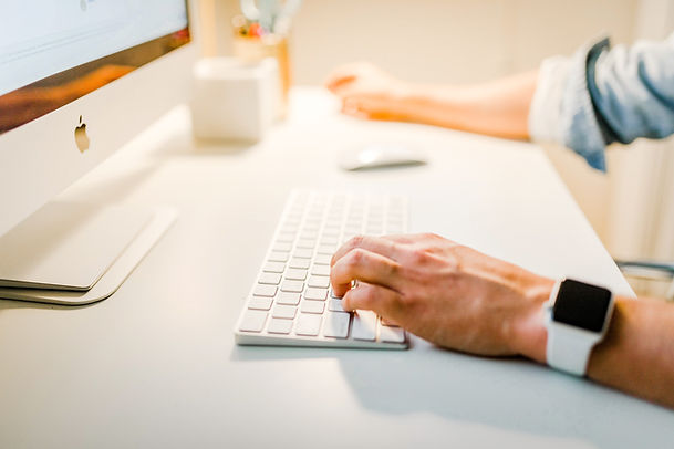 A person at a desktop computer